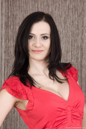 A beautiful Kaira strips naked from her red dress