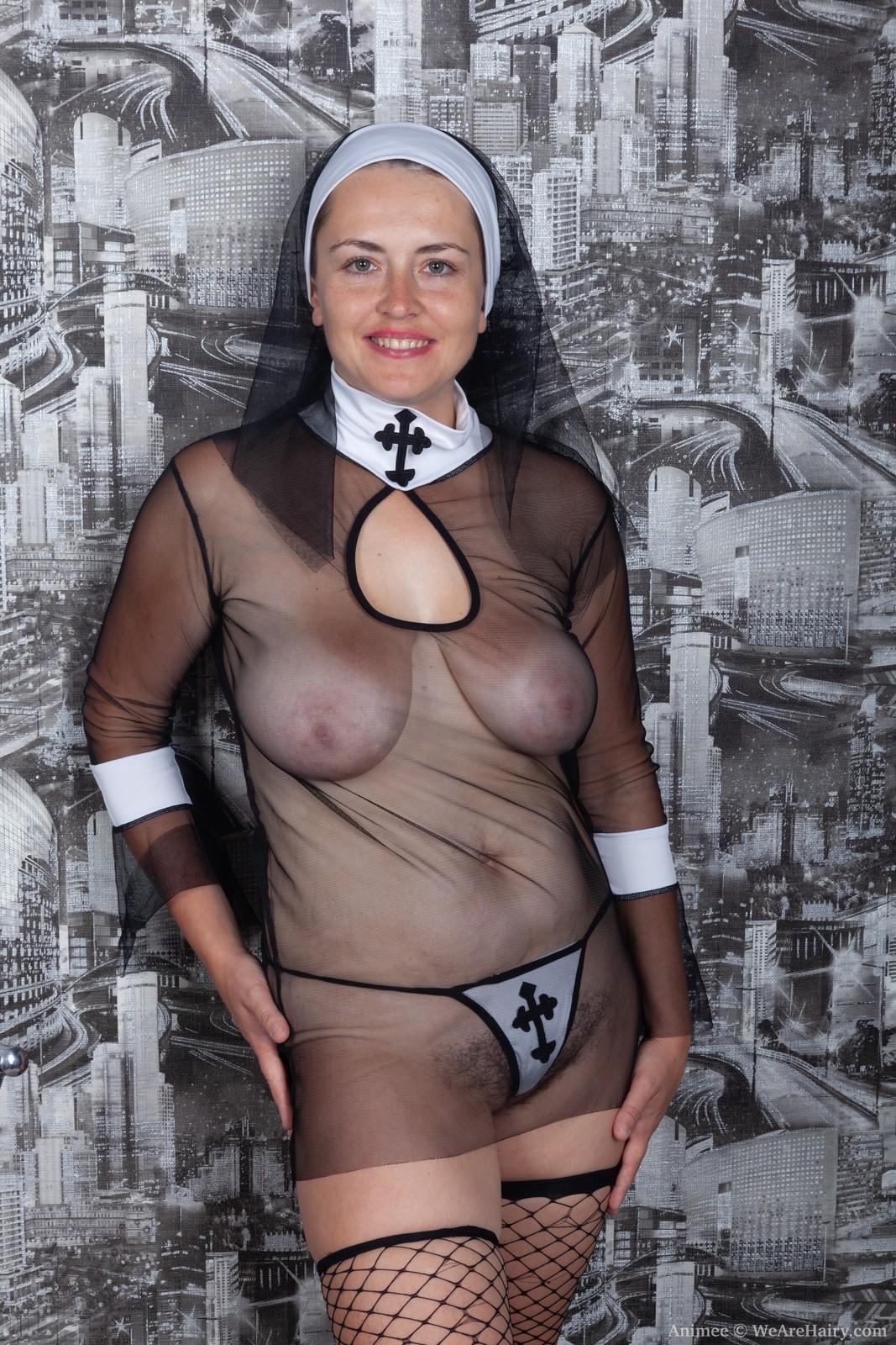 Animee dresses as a nun and then masturbates