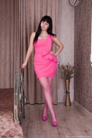 Dressed in pink Tayra Jane strips naked