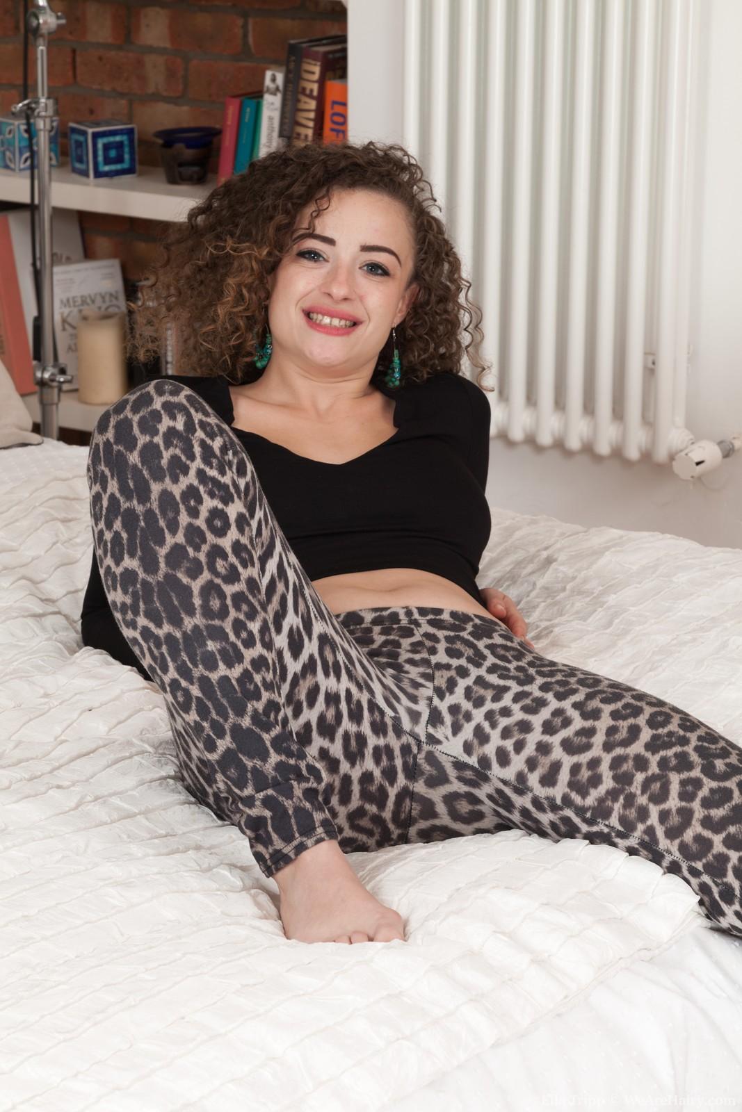 Ella Tripp models her new leopard pants in bed