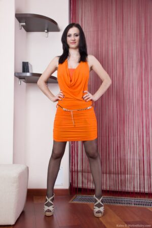Kaira undresses from her orange dress to her bed