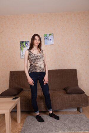 Marceline Moore strips naked on her sofa