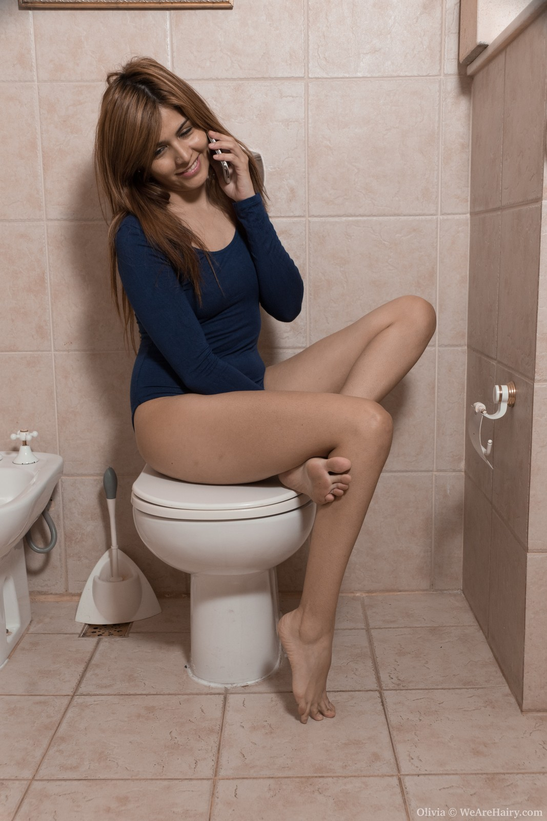 Olivia poses naked by toilet with a surprise