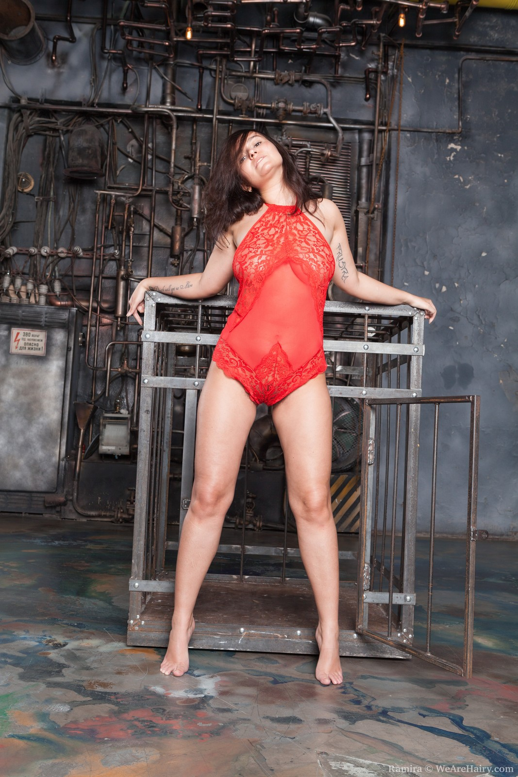 Ramira strips naked by her cage today