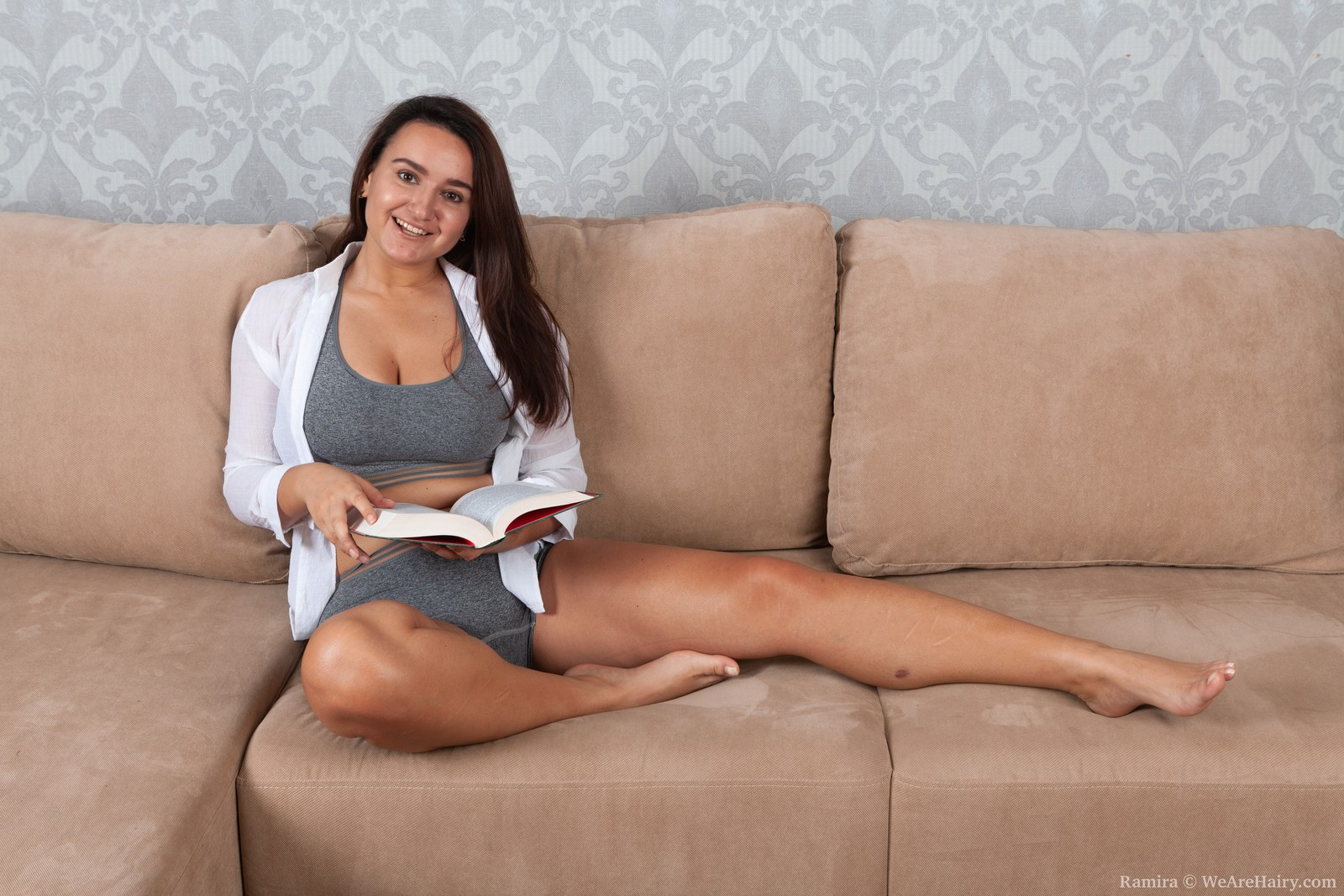 Ramira strips naked on her couch after reading